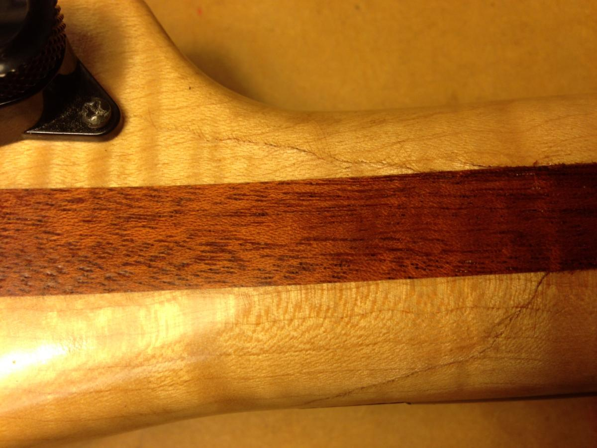 Headstock repair on and electric guitar - glued and refinished.